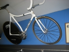 """Craig's Colian track pursuit bike with 700c Cinelli disc and 24"""" Aeros front wheel."""